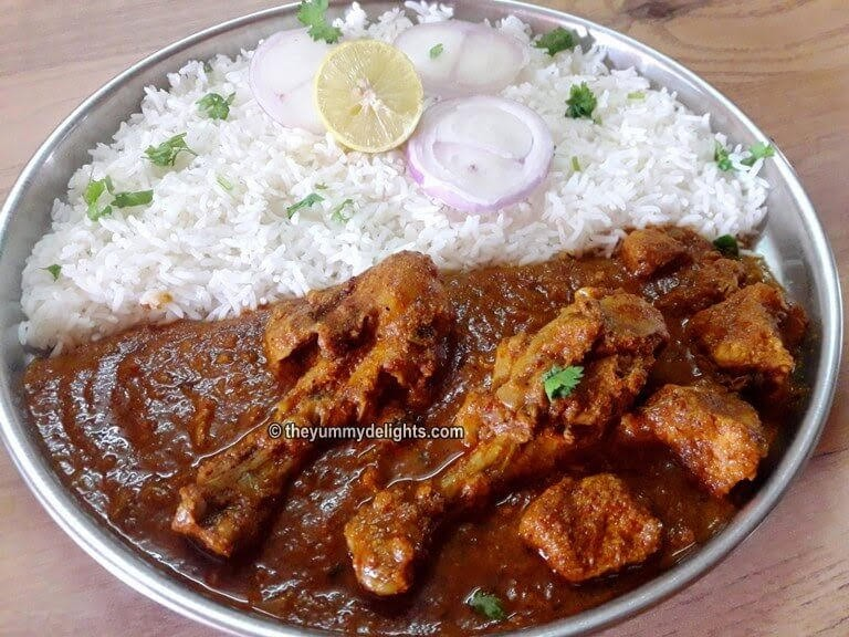 Malvani chicken curry served with steamed rice