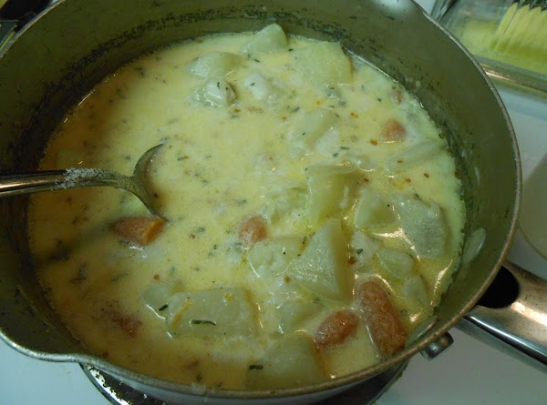 Add garlic, salt, pepper, summer savory, butter, half and half, and cheeses to the...