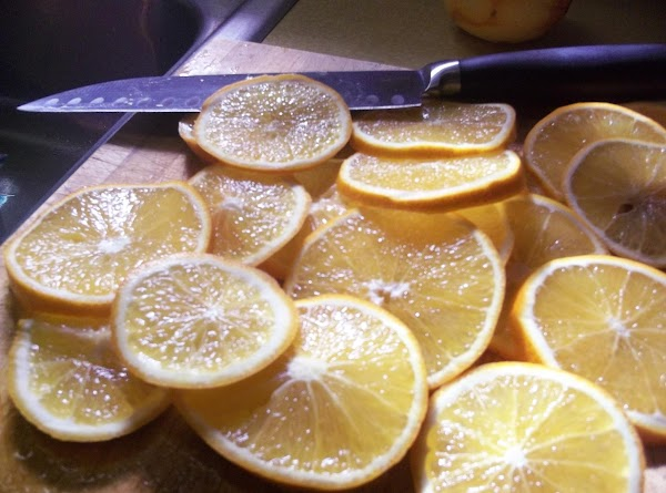 GARNISH: For the candied orange slices, thinly slice the two thin-skinned oranges. Bring the...