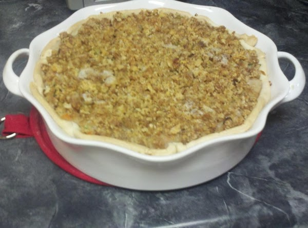 Crumble up the dressing and sprinkle it over the pie. Melt the 1/4 cup...
