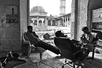 Photo: Free Syrian Army rebel fighters from the Liwa al-Tawhid brigade defend their post inside the Umayyad mosque located in the al-Jalloum district of the Old City in Aleppo, Syria. The Umayyad mosque, a World Heritage site, has been badly damaged during clashes between Syrian rebel fighters and government forces. Aleppo, SYRIA - 11/4/2013. Credit: Ali Mustafa/SIPA Press