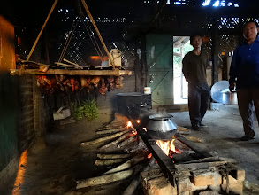Photo: Smoking the pork (hanging on the rack) over the wood fire as they are cooking for the conference. Life in this village is like turning the clock back more than 100 years in America. Their Indian indigenous ingenuity is very intriguing indeed.