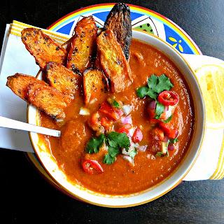 Vegan Nacho Soup with salsa & carrot dip chips.