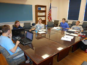 Photo: Students study the Cambridge History of Latin America at the Citadel before departure.