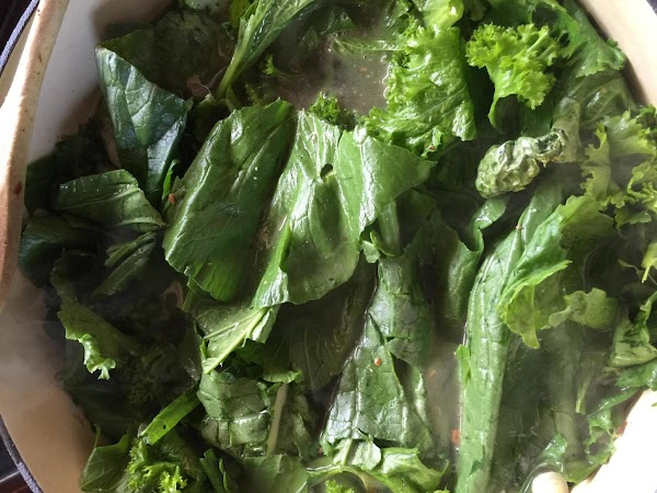 Add greens to pot, bring to a boil then reduce heat to medium low...