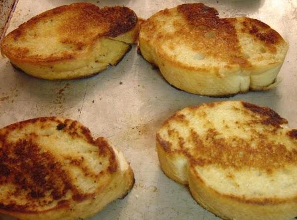 In a large skillet, melt butter. Dip each side of each slice of bread...