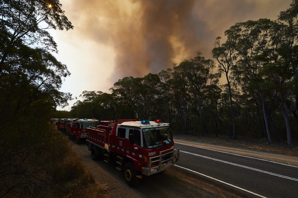 Evacuations ordered as 150 bushfires rage on two coasts in Australia