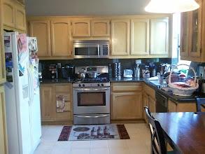 Photo: Kitchen with 2-door refrigerator, stainless steel stove, and microwave oven, maple cabinets
