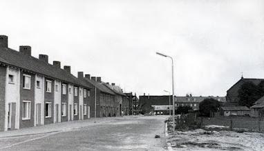 Photo: 1957 - Woningen Pater van den Elsenplein 12-1. doorbraak naar de Broekhovenseweg, rechts Pius X kerk