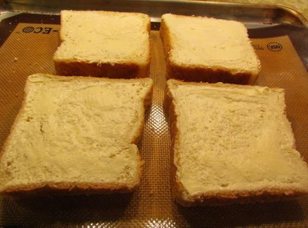 Prepare a cookie sheet with your slices of texas toast placed on it. Spread...