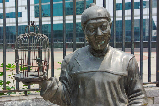 Beijing-statue - A statue with a bird cage (and, fortunately, no bird) in Beijing.
