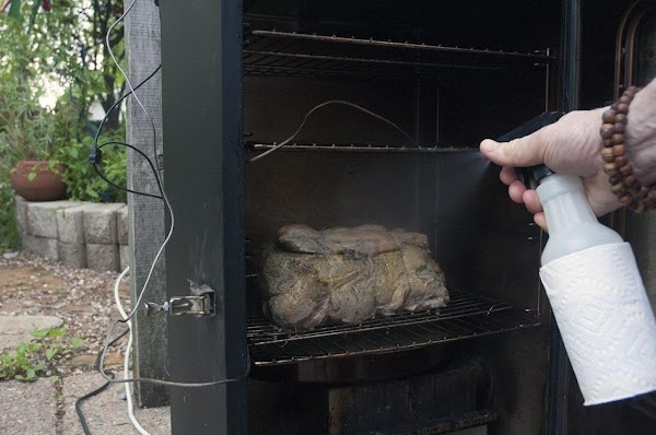 After the first two hours, open up the smoker, and spritz it (or mop...
