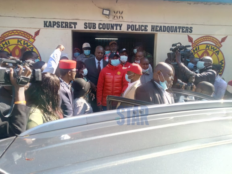 Kapsaret MP Oscar Sudi being escorted to a car at the Langas police station on September 13, 2020.