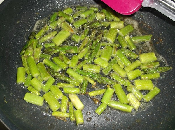 Melt 1 tablespoon butter in small nonstick pan; add fresh asparagus pieces; sauté over...