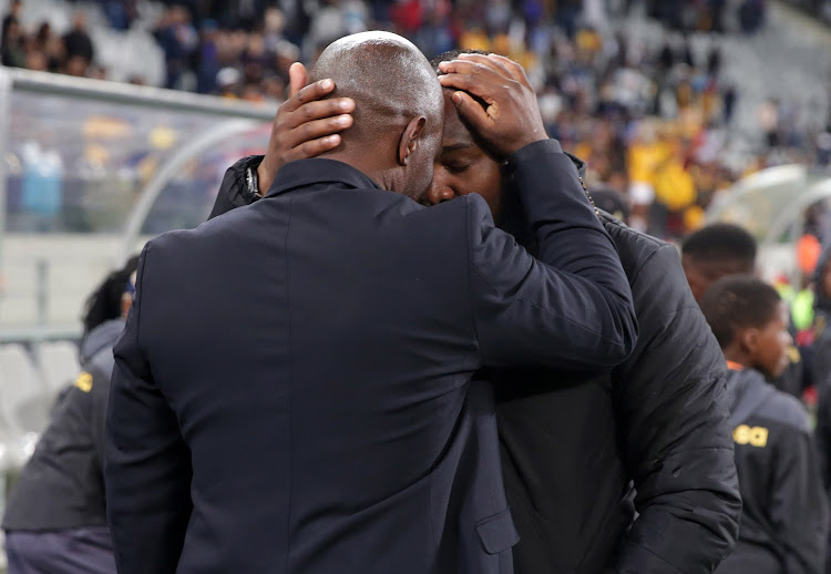 Steve Komphela, head coach of Kaizer Chiefs (l) and Benni McCarthy, head coach of Cape Town City share a moment during the Absa Premiership 2017/18 football match between Cape Town City FC and Kaizer Chiefs at Cape Town Stadium, Cape Town on 13 September 2017.