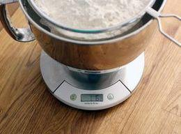 Sift the flour and salt into a large bowl.   Add the yeast mixture. Mix...