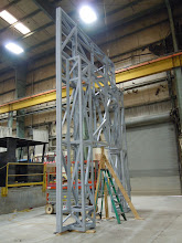Photo: Lincoln entry portal framework. After our industrial division fabricates this frame, it's assembled in our pit for the next round of attaching a plywood substrate.
