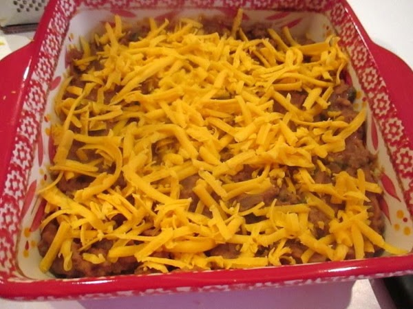 Top with remaining cheddar cheese and place in oven under broiler until cheese is...