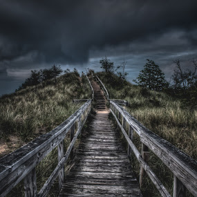 MAYBE IT MEANT SOMETHING by Erin Watson - Landscapes Prairies, Meadows & Fields ( clouds, climb, wood, grass, steps, storm, boardwalk, stairs, sky, erin watson photography, path, walkway, erin watson, bridge )