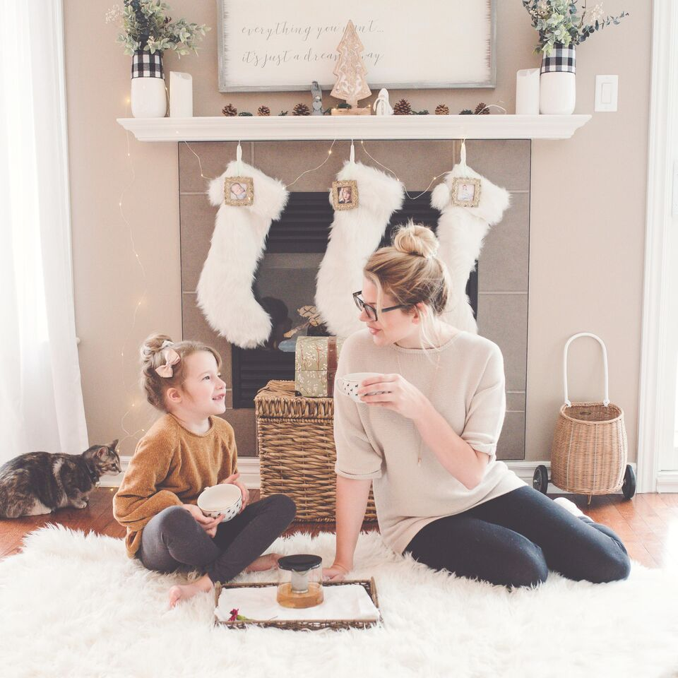 mother daughter fireplace stockings holiday decorating decluttering abrams home solutions chicago