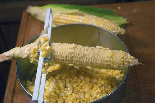 Shuck and remove the corn from the cobs.
