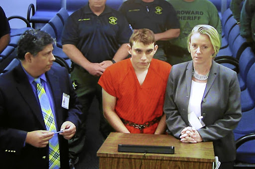 Nikolas Cruz appears via video monitor with Melisa McNeill, right, his public defender, at a bond court hearing after being charged with 17 counts of premeditated murder, in Fort Lauderdale, Florida, on February 15 2018. Picture: REUTERS