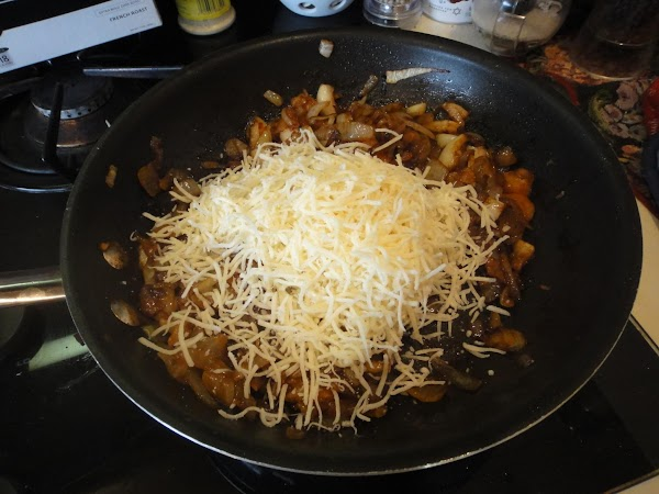 To the carmelized garlic and onions add 1 cup of swiss cheese and mix...