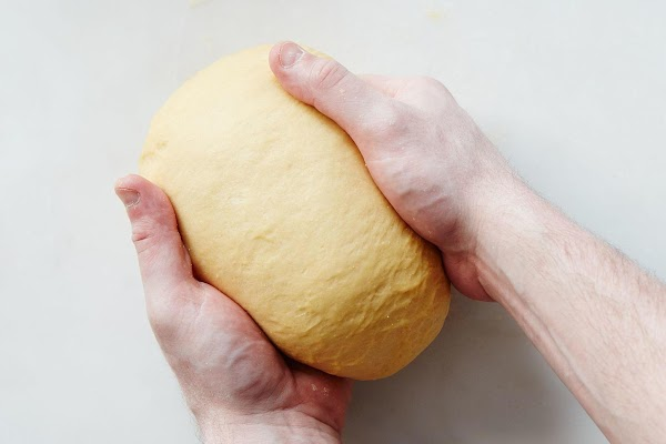 The final step is to let the dough rest. Cover it tightly in plastic...