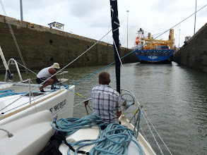 Photo: Once inside, the messenger line is pulled up and the heavier line is fastened to our nest of boats...