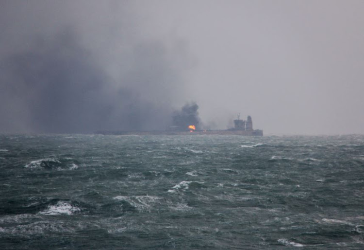 Smoke is seen from Panama-registered Sanchi tanker carrying Iranian oil that caught ablaze after it collided with a Chinese freight ship in the East China Sea, in this January 9, 2018 handout picture released by China's Ministry of Transport.