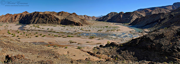 """Photo: """"River in a Dry Land..."""" Fish River Fish River Canyon, Namibia  This is a panoramic stitch of a view I had somewhere in the middle of our hike through this, the second largest canyon in the world (behind the Grand one, of course), back in 2009. The light was harsh, but then again when you are hiking on the floor of a massive canyon then the good light doesn't really penetrate to where you are. This river looks small but you can see the crevasse it's carved through the years.  There's still time to get some images submitted to African Tuesday """"Raging Rivers"""", so don't hesitate! Tag your images with #AfricanTuesday """"Raging Rivers"""", tag myself and +Johan Swanepoel(the curators) and also tag the +African Tuesdaypage.  www.morkelerasmus.com  Submission for: 1. #landscapephotography (+Landscape Photography) by +Carra Riley+Margaret Tompkinsetc. 2. #widewednesdaypanorama (+WideWednesdayPanorama) - an early one - by +Lucille Galleli& +Ken McMahon 3. #panopoker Panoramics by +Mike Spinak+Barry Blanchard+Tony Payne& +Monique Yates 4. #hqsppromotion (+HQSPPromotion)  #fishrivercanyon  #namibia  #hiking  #desert  #panorama  #travel  #canyon"""