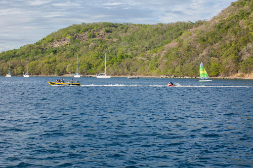water-sports-in-guadeloupe.jpg - Wind Surf passengers go for a spin in a speedboat in Guadeloupe.