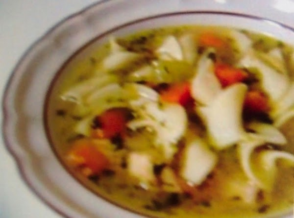 Bring the broth to a boil in a large pot. Add onion,garlic,celery, carrots and herbs. Reduce...