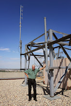 Photo: Mark VE4MAB standing beside the new home for our D-STAR Repeater