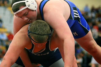Photo: 285 Sam Stoll (Kasson-Mantorville) over Nathan Horn (Jackson County Central) Fall 1:10. Photo by Mark Beshey