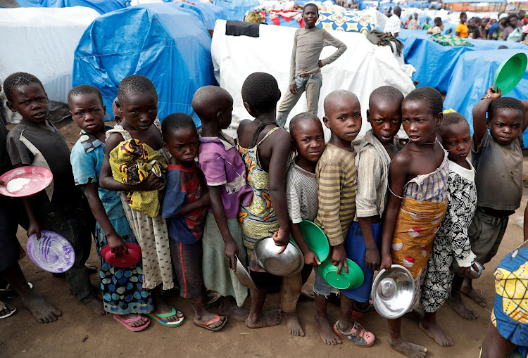 Internally displaced children wait for food distribution at an internally displaced persons (IDP) camp in Bunia, Ituri province, eastern Democratic Republic of Congo, April 12 2018. REUTERS/Goran Tomasevic