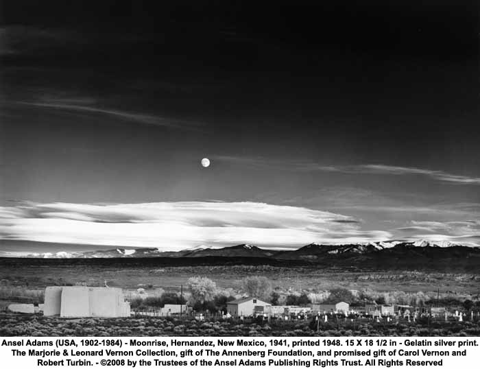 A black and white image of moonrise at Hernandez, New Mexico, 1941, by famous photographer Ansel Adams