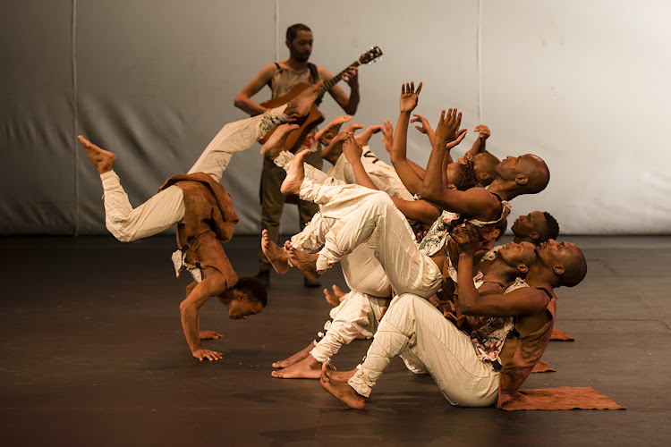 Moving Into Dance Mophatong with musician Matthew MacFarlane in Sunnyboy Motau's 'I am NoT' at the Wits Theatre
