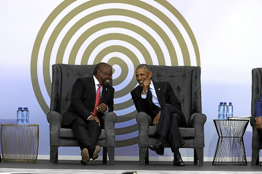 President Cyril Ramaphosa and former US president Barack Obama share a moment at the 16th Nelson Mandela Annual Lecture at the Wanderers Stadium in Johannesburg.