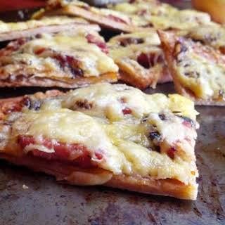 Smoked Sausage Thin Crust Pizza With Caramelized Onion-Apricot Jam and Gouda.
