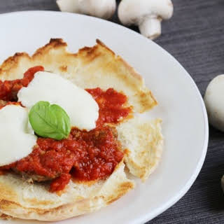 Open Faced Mushroom Meatball Parmigiana Sandwiches.