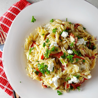 Creamy Orzo Pasta with Goat Cheese, Sun Dried Tomato and Roasted Red Pepper.