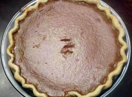 "Mom's Pumpkin Pie ""Dark, rich, and creamy, this recipe has been handed..."