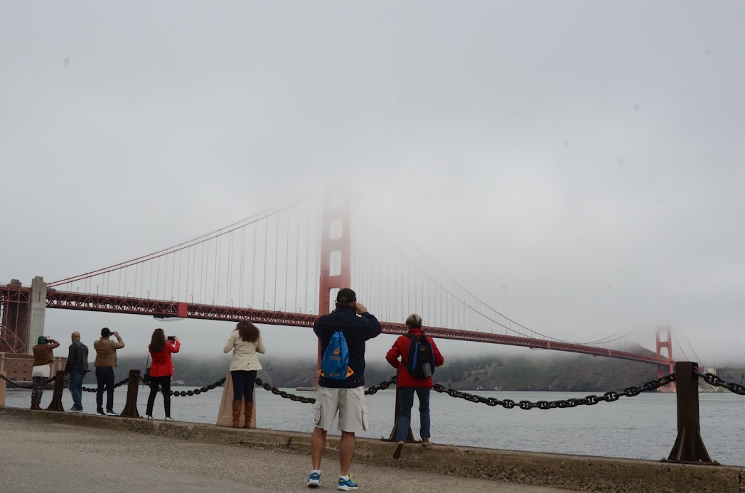 Tourists and visitors taking picture of the bridge