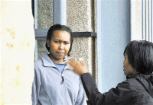 ACCUSED: Lerato Mbali Dasa outside court on Friday.Pic. Vathiswa Ruselo. 26/10/2008. © Sowetan