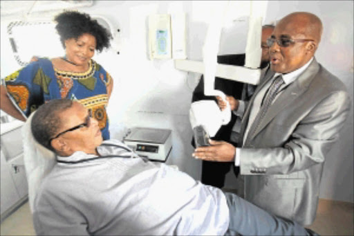 EXPERT TREATMENT: Health Minister Aaron Motsoaledi showing member of parliament Dennis Bloem the equipment in the truck that will visit schools as part of the school health pilot program. National Council of Provinces member Priscilla Themba looks on. Photo: Veli Nhlapo
