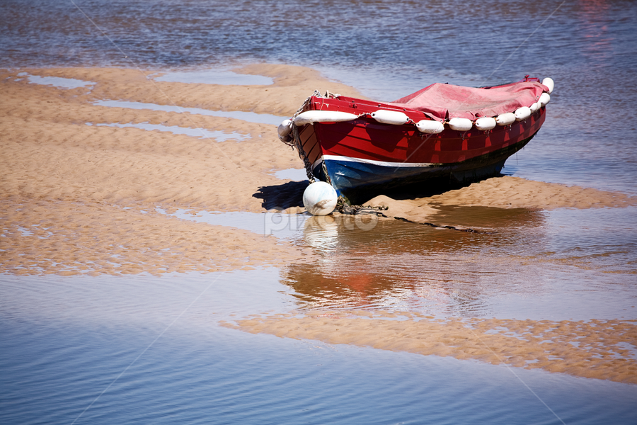 High and Dry by Joanne Santillo - Transportation Boats ( water, sand, red, blue, bouy, white, sea, ripple, bank, boat )