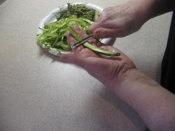 Cut up asparagus in bite size pieces, removing top and breaking off bottom parts...make...