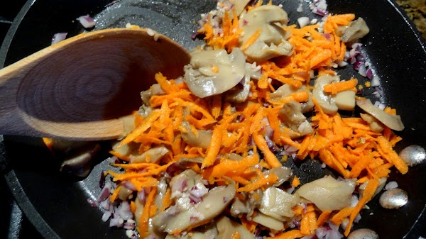 Add mushrooms and grated carrots. Saute just two minutes more, and remove from heat.