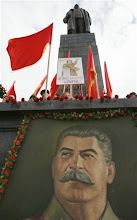 Photo: With a statue, background, and  portrait, foreground, of Soviet dictator Josef Stalin, Georgians attend a rally marking his 130th birthday anniversary in Stalin's home town of Gori, 80 km (50 miles) west of the Georgian capital Tbilisi, Monday, Dec. 21, 2009. (AP Photo/Shakh Aivazov)